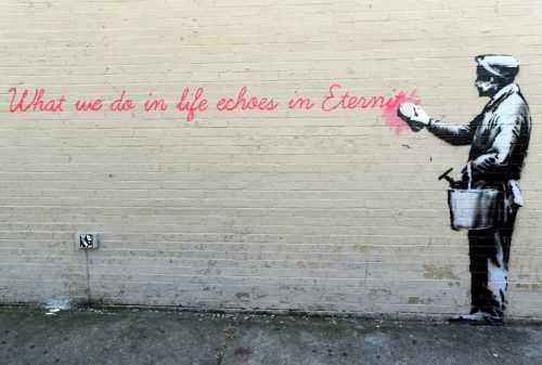 Banksy - Uomo che cancella la scritta