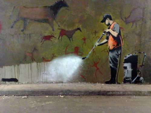 Banksy - Uomo che cancella i murales